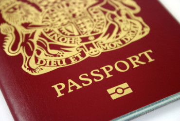 New Style British Passport with Microchip Data. Focus at 'Passport' and 'Camera Icon' Narrow DOF
